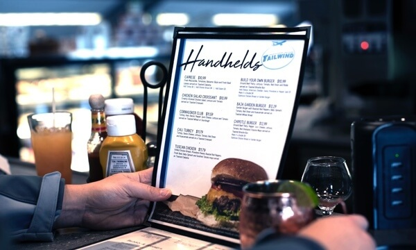person holding a restaurant menu